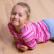 Little girl on the floor — Stock Photo