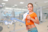 Young woman in fitness club — Stock Photo