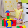 Stock Photo: Little girl with plastic cubes