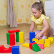 Girl playing with plasic cubes — Stock Photo