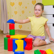 Girl playing with plasic cubes — Stock Photo #15659235