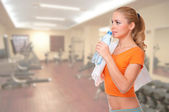 Young woman at fitness club — Stock Photo