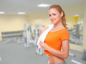 Young woman on fitness club — Stock Photo