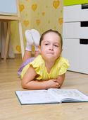 Little girl reading book — Stock Photo