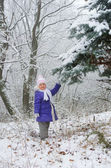 Girl in the winter forest — Stock Photo