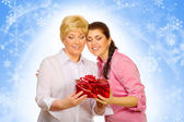 Daughter giving gift to her mother — Stock Photo