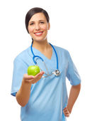Young doctor with green apple — Stock Photo