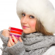 Young girl with fur hat and mug — Stockfoto