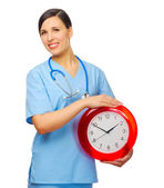 Young doctor with clock — Stock Photo