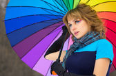 Young woman with multicolor umbrella — Stock Photo