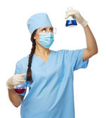 Young chemist with vials — Stock Photo