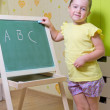 Stock Photo: Little girl with blackboard