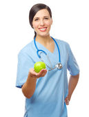Medico con mela verde — Foto Stock