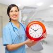 Doctor with clock — Stock Photo