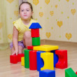 Little girl playing with cubes — Stock Photo #22000095