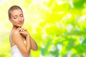 Young healthy girl on floral background — Stock Photo