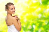 Young healthy girl on spring background — Stock Photo