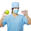 Doctor with apple and pills — Stock Photo #22758492