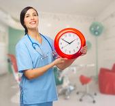 Doktor s hodinami — Stock fotografie