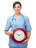 Doctor with clock isolated — Stock Photo