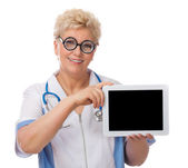 Mature doctor with tablet PC — Stock Photo