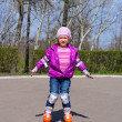 Little girl skating on roller skates — Stock Photo