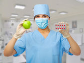 Doctor with pills and apple — Stock Photo