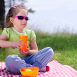 Little girl with picnic basket and plastic cup — Stock Photo #25808949