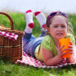 Little girl with picnic basket and plastic cup — Stock Photo #26141241