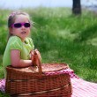 Little girl with picnic basket — Photo