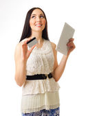 Young girl with credit card and tablet PC — Stock Photo