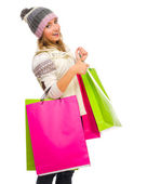 Young girl with bags shows ok gesture — Stock Photo