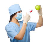 Biochemist with apple and syringe — Stock Photo