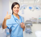 Young doctor shows ok gesture — Stock Photo