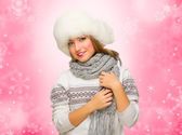 Girl with fur hat on winter background — Stock Photo