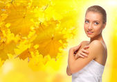Young girl on autumnal background — Stock Photo