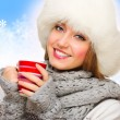 Girl with mug on winter background — Stock Photo