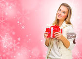 Girl with gift box on winter background — Stock Photo