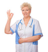 Mature doctor shows ok gesture — Stock Photo