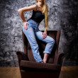 Portrait of girl on chair — Stock Photo