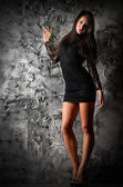 Fashion portrait of young girl on grey wall — ストック写真