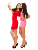 Two young girls with mobile phones — ストック写真