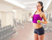 Sporty girl with apple at gym club — Stock Photo