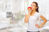 Girl with apple at light room — Stok fotoğraf