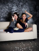 Two angry girls looks TV — Stock Photo