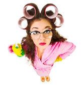 Funny housewife with sprayer — Stok fotoğraf
