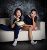 Two girls looks TV — Stock Photo