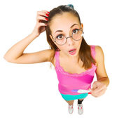 Funny schoolgirl in nerd glasses with positive pregnacy test — Stock Photo