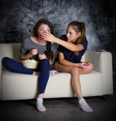 Two young girls looks TV — Stock Photo