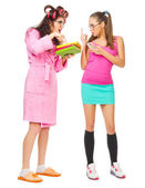 Angry mother with books screams to her daughter — Stock Photo